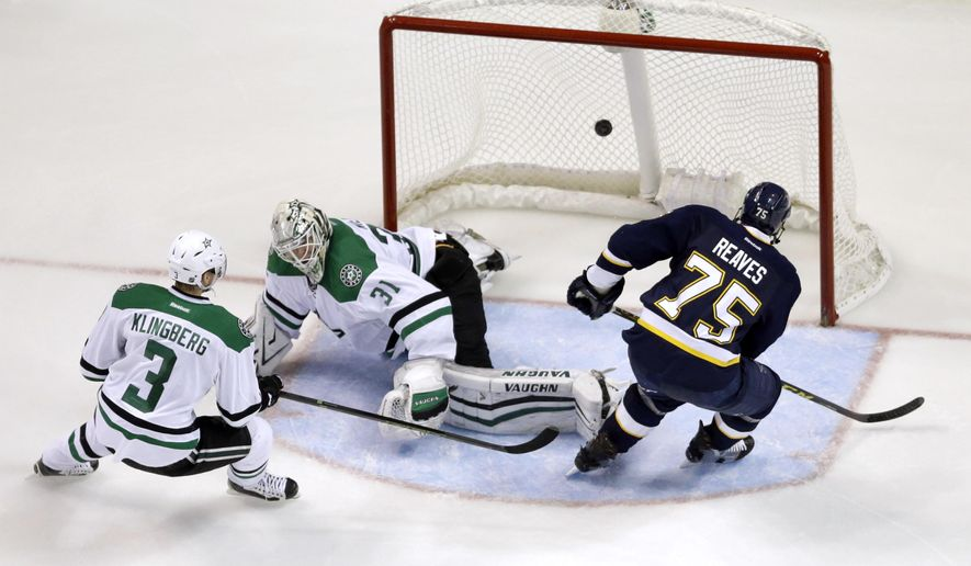 St. Louis Blues' Ryan Reaves, right, scores past Dallas Stars goalie Antti Niemi, of Finland, and John Klingberg, left, of Sweden, during the third period of an NHL hockey game Saturday, Dec. 12, 2015, in St. Louis. The Blues won 3-0. (AP Photo/Jeff Roberson)