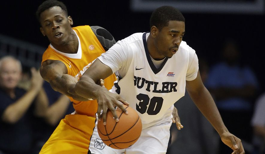 Butler's Kelan Martin (30) is defended by Tennessee's Devon Baulkman during the second half of an NCAA college basketball game Saturday, Dec. 12, 2015, in Indianapolis. Butler won 94-86. (AP Photo/Darron Cummings)