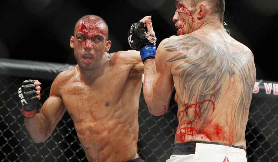Edson Barboza, left, hits Tony Ferguson in a lightweight bout during The Ultimate Fighter finale Friday, Dec. 11, 2015, in Las Vegas. (AP Photo/John Locher)