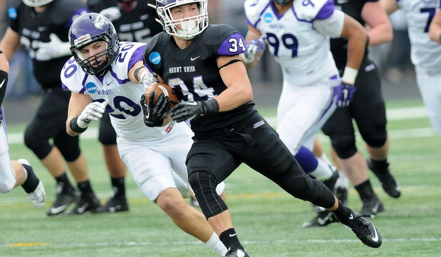 Mount Union Logan Nemeth (34) carries on a long run from scrimmage as Wisconsin-Whitewater's Shawn Shilcox pursues in the third quarter of  the semifinals of an NCAA Division III college football game, Saturday, Dec. 12, 2015, in Alliance, Ohio. (Ed Hall Jr./The Review via AP) MANDATORY CREDIT