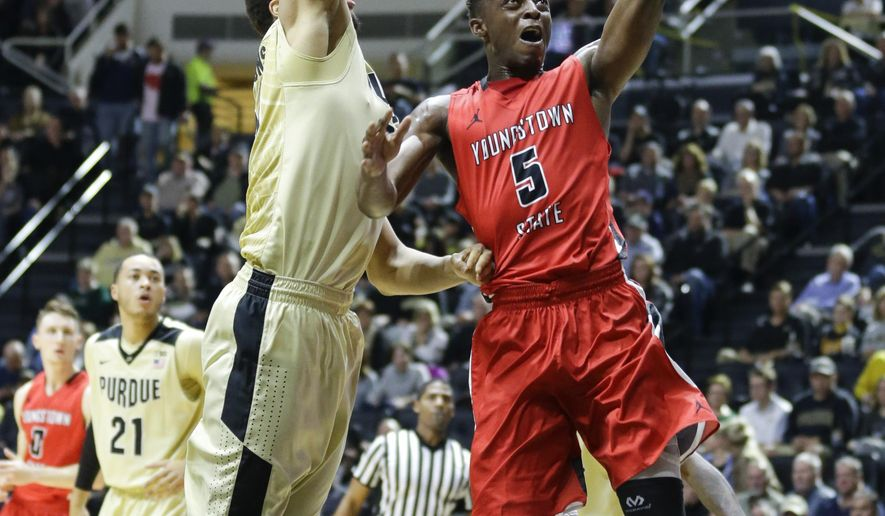 Youngstown State forward Sidney Umude (5) shoots past Purdue center A.J. Hammons (20 in the first half of an NCAA college basketball game in West Lafayette, Ind., Saturday, Dec. 12, 2015. (AP Photo/Michael Conroy)