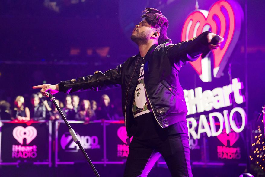 The Weeknd performs at Z100's iHeartRadio Jingle Ball 2015 at Madison Square Garden on Saturday, Dec. 12, 2015, in New York. (Photo by Charles Sykes/Invision/AP)