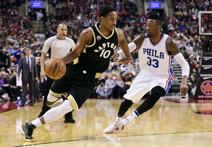 Toronto Raptors' DeMar DeRozan, left, drives past Philadelphia 76ers' Robert Covington during first half of an NBA basketball game in Toronto, Sunday, Dec. 13, 2015. (Frank Gunn/The Canadian Press via AP) MANDATORY CREDIT