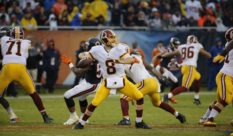 Washington Redskins quarterback Kirk Cousins (8) passes against the Chicago Bears during the second half of an NFL football game, Sunday, Dec. 13, 2015, in Chicago. (AP Photo/Charles Rex Arbogast)
