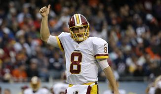 Washington Redskins quarterback Kirk Cousins (8) reacts after a touchdown during the first half of an NFL football game against the Chicago Bears, Sunday, Dec. 13, 2015, in Chicago. (AP Photo/Nam Y. Huh)