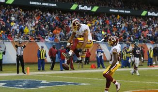 Washington Redskins tight end Jordan Reed (86) spikes the ball as he celebrates a touchdown during the second half of an NFL football game against the Chicago Bears, Sunday, Dec. 13, 2015, in Chicago. (AP Photo/Charles Rex Arbogast)