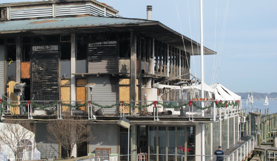 The the Annapolis Yacht Club is seen on Sunday Dec. 13, 2015, in Annapolis, Md. Fire officials in Annapolis are working in the rubble to find the cause of a fire that badly damaged it a day earlier. Rod Jabin, the club's commodore, said the club founded in 1886 is looking to relocate for now. (AP Photo/Brian Witte)