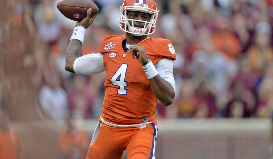 FILE - In this Nov. 7, 2015, file photo, Clemson quarterback Deshaun Watson throws a pass during the first half of an NCAA college football game against Florida State in Clemson, S.C. Watson has been named to the AP All-America team football team. (AP Photo/Richard Shiro, File)