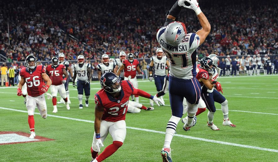 New England Patriots tight end Rob Gronkowski (87) catches a pass for a touchdown over Houston Texans strong safety Quintin Demps (27) during the first hall of an NFL football game Sunday,  Dec. 13, 2015, in Houston. (AP Photo/George Bridges)