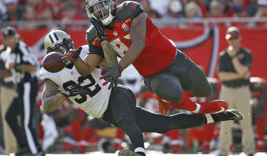 Tampa Bay Buccaneers tight end Austin Seferian-Jenkins (87) can't hang onto a pass as he battles with New Orleans Saints strong safety Kenny Vaccaro (32) during the fourth quarter of an NFL football game Sunday, Dec. 13, 2015, in Tampa, Fla. (AP Photo/Brian Blanco)
