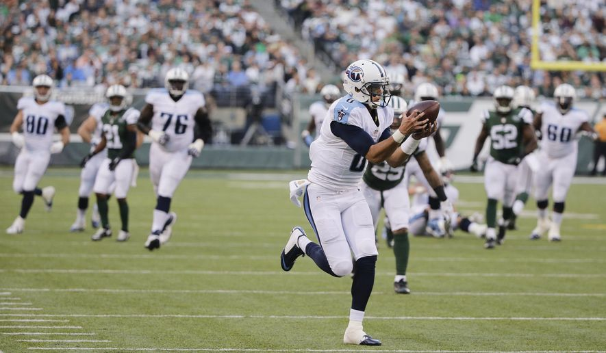 Tennessee Titans quarterback Marcus Mariota (8) catches a pass during the second half of an NFL football game against the New York Jets Sunday, Dec. 13, 2015, in East Rutherford, N.J.  Mariota scored a touchdown on the play. (AP Photo/Julie Jacobson)