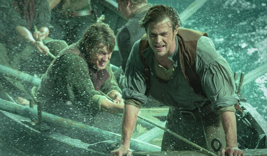 "This photo provided by Warner Bros. Pictures shows, Chris Hemsworth, right, as Owen Chase, and Sam Keeley as Ramsdell, left, in a scene from the film, ""In the Heart of the Sea."" The movie opens in U.S. theaters on Dec. 11, 2015. (Jonathan Prime/Warner Bros. Pictures via AP)"