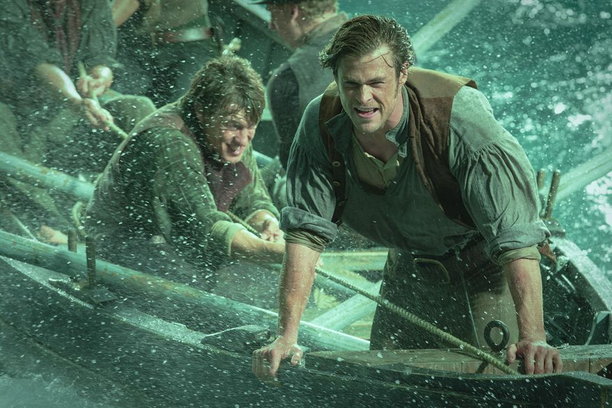 """This photo provided by Warner Bros. Pictures shows, Chris Hemsworth, right, as Owen Chase, and Sam Keeley as Ramsdell, left, in a scene from the film, """"In the Heart of the Sea."""" The movie opens in U.S. theaters on Dec. 11, 2015. (Jonathan Prime/Warner Bros. Pictures via AP)"""