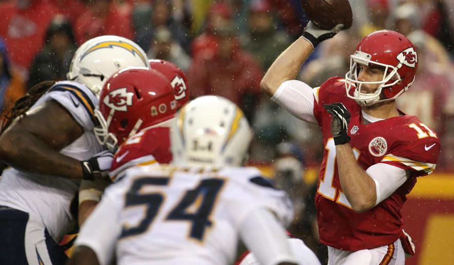 Kansas City Chiefs quarterback Alex Smith (11) throws during the first half of an NFL football game against the San Diego Chargers in Kansas City, Mo., Sunday, Dec. 13, 2015. (AP Photo/Charlie Riedel)