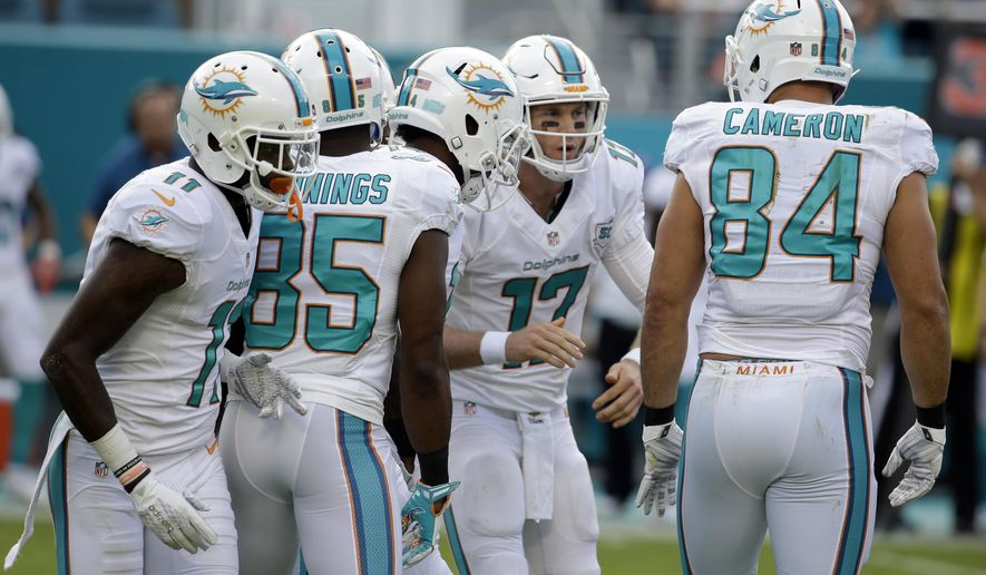 FILE - In this Dec. 6, 2015, file photo, Miami Dolphins quarterback Ryan Tannehill (17) huddles with the offensive during the first half of an NFL football game against the Baltimore Ravens in Miami Gardens, Fla.  Tannehill is coming off one of his least productive games and adjusting to yet another play-caller for the Dolphins as they prepare to face the New York Giants on  Monday, Dec. 14, 2015, whose pass defense ranks last in the NFL. (AP Photo/Lynne Sladky, File)