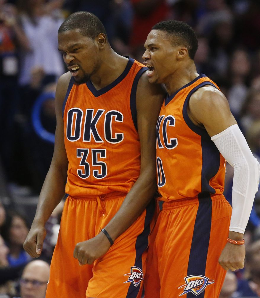 Oklahoma City Thunder forward Kevin Durant (35) and guard Russell Westbrook, right, shout after a 3-point basket by Durant in the third quarter of an NBA basketball game against the Utah Jazz in Oklahoma City, Sunday, Dec. 13, 2015. (AP Photo/Sue Ogrocki)