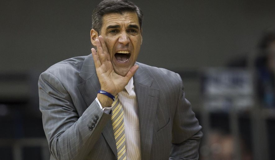 Villanova head coach Jay Wright shouts from the bench in the first half of an NCAA college basketball game against La Salle, Sunday, Dec. 13, 2015, in Villanova, Pa.  (AP Photo/Laurence Kesterson)