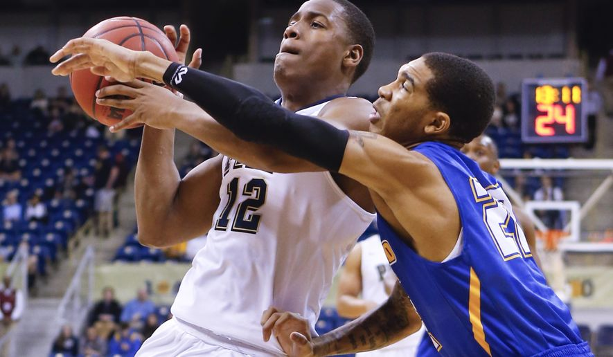 Pittsburgh's Chris Jones (12) goes up to shoot as Morehead State's Xavier Moon defends in the first half of an NCAA college basketball game, Sunday, Dec. 13, 2015, in Pittsburgh. (AP Photo/Keith Srakocic)