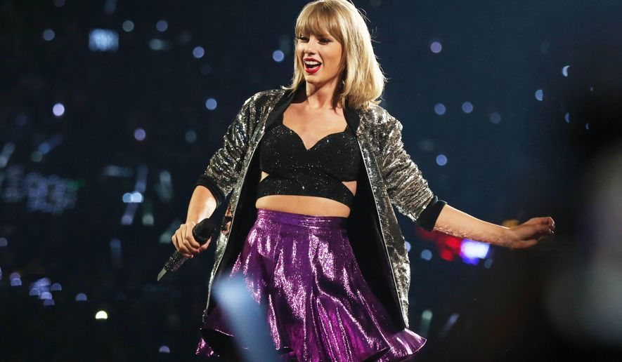 "FILE - In this Saturday, Aug. 22, 2015, file photo, Taylor Swift performs during the ""1989"" world tour at Staples Center in Los Angeles. Swift is releasing a live concert special on Dec. 20, from her star-studded ""1989 World Tour"" exclusively on Apple Music, the pop star announced Sunday, Dec. 13, 2015. (Photo by Matt Sayles/Invision/AP, File)"