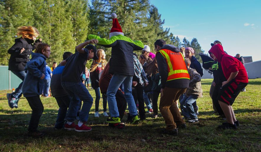 ADVANCE FOR THE WEEKEND OF DEC. 12-13 AND THEREAFTER - In this Dec. 1, 2015 photo, sixth-grade students jump in the air to help researchers measure the way seismic waves move through soil at Lackamas Elementary School in Yelm, Thurston County, Wash. (Ellen M. Banner/The Seattle Times via AP) SEATTLE OUT; USA TODAY OUT; MAGS OUT; TELEVISION OUT; NO SALES; MANDATORY CREDIT TO BOTH THE SEATTLE TIMES AND THE PHOTOGRAPHER, ELLEN M. BANNER