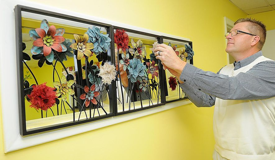 ADVANCE FOR MONDAY, DEC. 14 AND THEREAFTER - This Monday, Nov. 9, 2015 photo shows Billy Bush, president of Ficon-Bush Inc., in the dinning Room at the Woman's Resource Center for women and children escaping from domestic violence, in Beckley, W.Va. (Rick Barbero/The Register-Herald via AP)