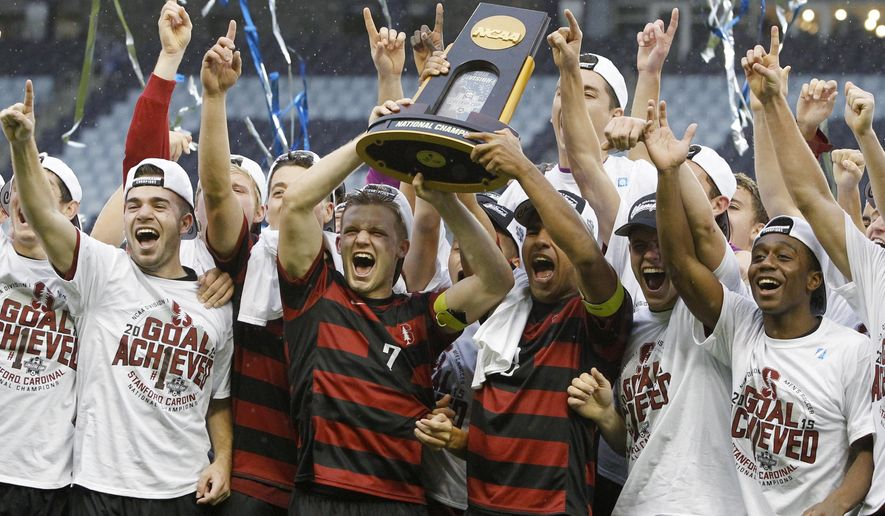 Members of the Stanford soccer team celebrate after winning the NCAA College Cup championship soccer match against Clemson, Sunday, Dec. 13, 2015, in Kansas City, Kan. Stanford defeated Clemson 4-0. (AP Photo/Colin E. Braley)