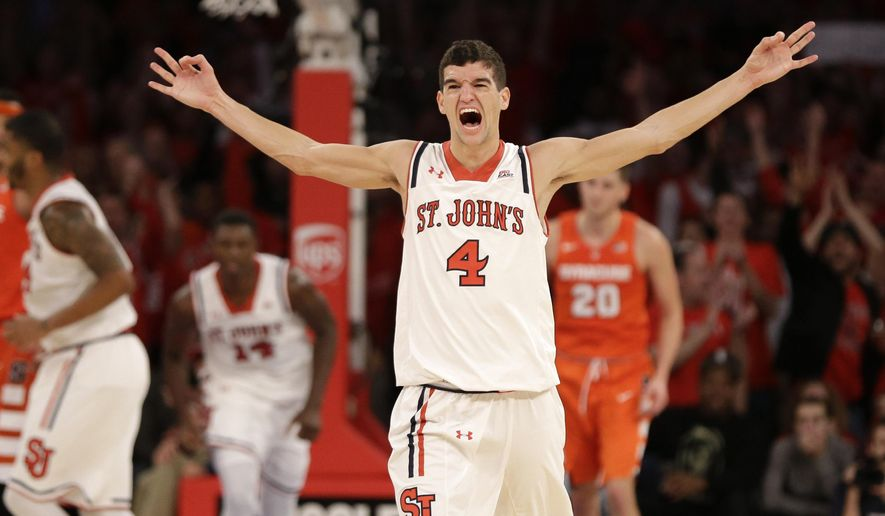 St. John's Federico Mussini reacts after hitting a 3-point basket during the first half of an NCAA college basketball game against Syracuse, Sunday, Dec. 13, 2015, in New York. (AP Photo/Seth Wenig)