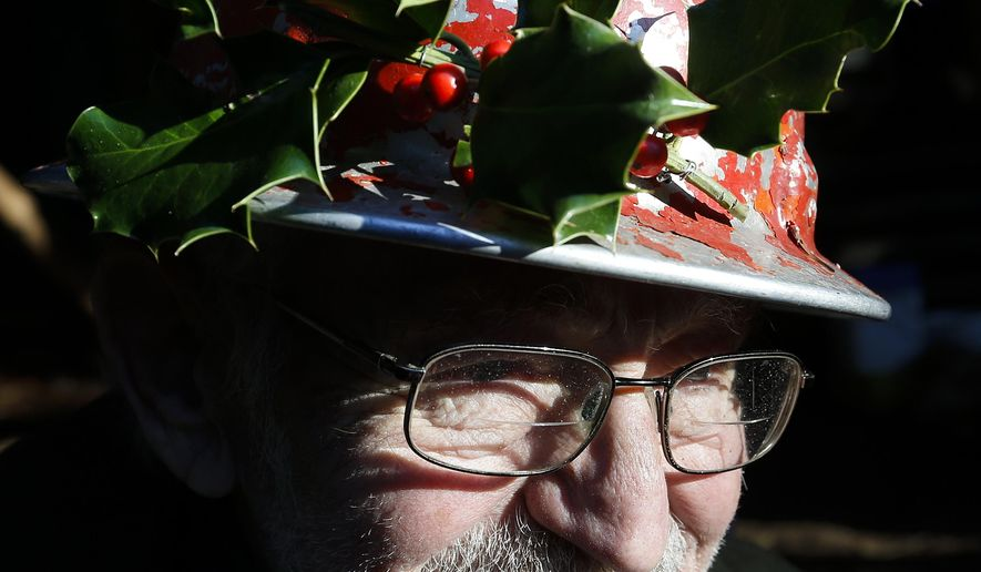 ADVANCE FOR SUNDAY DEC. 13 AND THEREAFTER - In a Saturday, Nov. 28, 2015 photo, 93-year-old Clayton Haberman sports a hard hat decorated with holly at the Happy Valley Tree Farm, which he owns with his wife, Barbara, in Stanwood, Wash. Clayton and Barbara Haberman purchased the 25-acre property in 1968 and began selling Christmas trees in 1977. They say this may be their last year selling trees.  (Ian Terry/The Herald via AP)