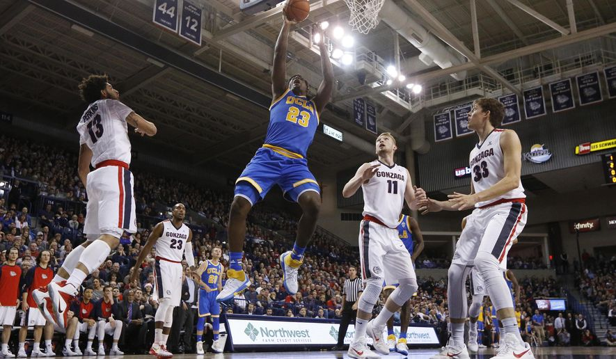 UCLA's Tony Parker (23) shoots in front of Gonzaga's Josh Perkins (13), Domantas Sabonis (11) and Kyle Wiltjer (33) during the first half of an NCAA college basketball game, Saturday, Dec. 12, 2015, in Spokane, Wash. (AP Photo/Young Kwak)