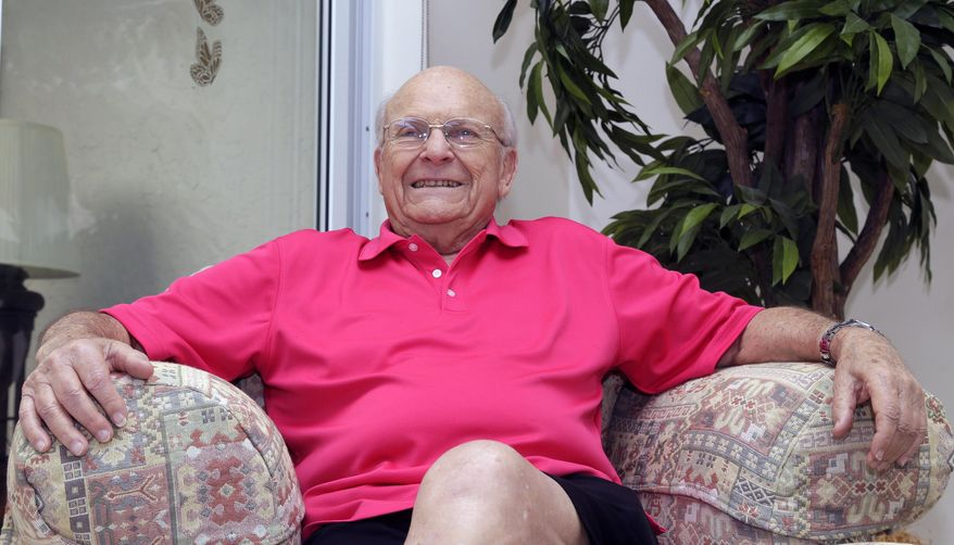 Aortic valve surgery patient Irwin Weiner poses for a photo, Friday, Dec. 11, 2015, at his home in Boca Raton, Fla. Very old age is no longer an automatic barrier for aggressive therapies, from cancer care, to major heart procedures, joint replacements and even organ transplants. (AP Photo/Alan Diaz)