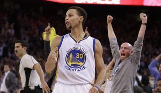 Golden State Warriors' Stephen Curry celebrates a score against the Los Angeles Clippers during the second half of an NBA basketball game Wednesday, Nov. 4, 2015, in Oakland, Calif. The Warriors won 112-108. (AP Photo/Ben Margot)
