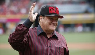 "Former Cincinnati Reds great Pete Rose waves on the field at Great American Ball Park before a baseball game between the Cincinnati Reds and the St. Louis Cardinals, Saturday, Sept. 12, 2015, in Cincinnati. During a brief ceremony, the City of Cincinnati declared Sept. 12, 2015 ""Pete Rose Day."" (AP Photo/John Minchillo)"