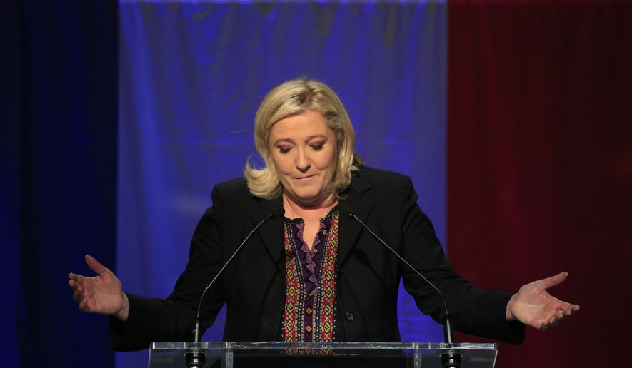 Far Right National Front party leader Marine Le Pen delivers her speech after the results of the second round of the regional elections in Henin-Beaumont, northern France, Sunday Dec.13, 2015. Marine Le Pen's far-right National Front collapsed in French regional elections Sunday after dominating the first round of voting, according to pollsters' projections. (AP Photo/Thibault Camus)