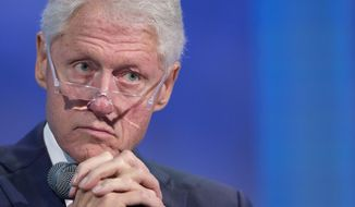 Former President Bill Clinton pauses at the Clinton Global Initiative in New York on Sept. 27, 2015. (Associated Press) **FILE**