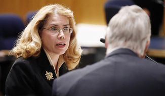 Former Phoenix VA Health Care System worker Dr. Katherine Mitchell, left, talks with Vietnam veteran Chuck Byers, right, before the two testify about the current state of the VA Medical Center in Phoenix during a Senate Veterans' Affairs Committee field hearing Monday, Dec. 14, 2015, in Gilbert, Ariz. (AP Photo/Ross D. Franklin)