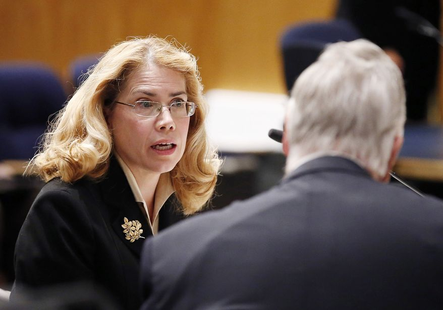 Former Phoenix VA Health Care System worker Dr. Katherine Mitchell, left, talks with Vietnam veteran Chuck Byers, right, before the two testify about the current state of the VA Medical Center in Phoenix during a Senate Veterans' Affairs Committee field hearing Monday, Dec. 14, 2015, in Gilbert, Ariz. (AP Photo/Ross D. Franklin) **FILE**