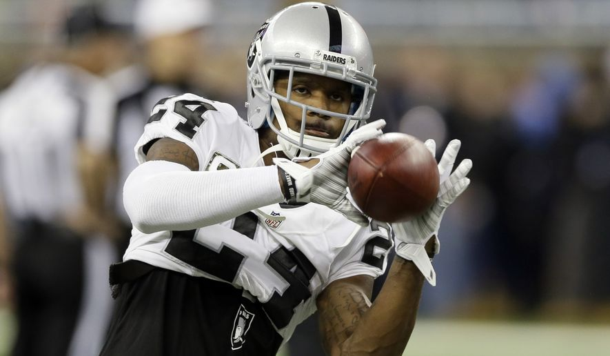 FILE - In this Nov. 22, 2015, file photo, Oakland Raiders free safety Charles Woodson (24) catches during warmups before an NFL football game against the Detroit Lions, in Detroit. The eight finalists for the second annual Art Rooney Sportsmanship Award have been finalized, the NFL announced Monday, Dec. 15, 2015. The finalists, featuring four players from each conference, are Justin Forsett, Matt Forte, Luke Kuechly, Matt Hasselbeck, Calvin Johnson, Jason McCourty, Joe Staley and Charles Woodson. (AP Photo/Carlos Osorio, File)