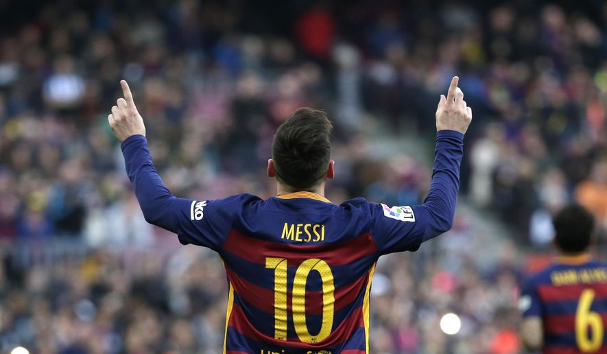 Barcelona's Lionel Messi celebrates scoring the opening goal during a Spanish La Liga soccer match between FC Barcelona and Deportivo Coruna at the Camp Nou stadium in Barcelona, Spain, Saturday, Dec. 12, 2015. (AP Photo/ Emilio Morenatti)