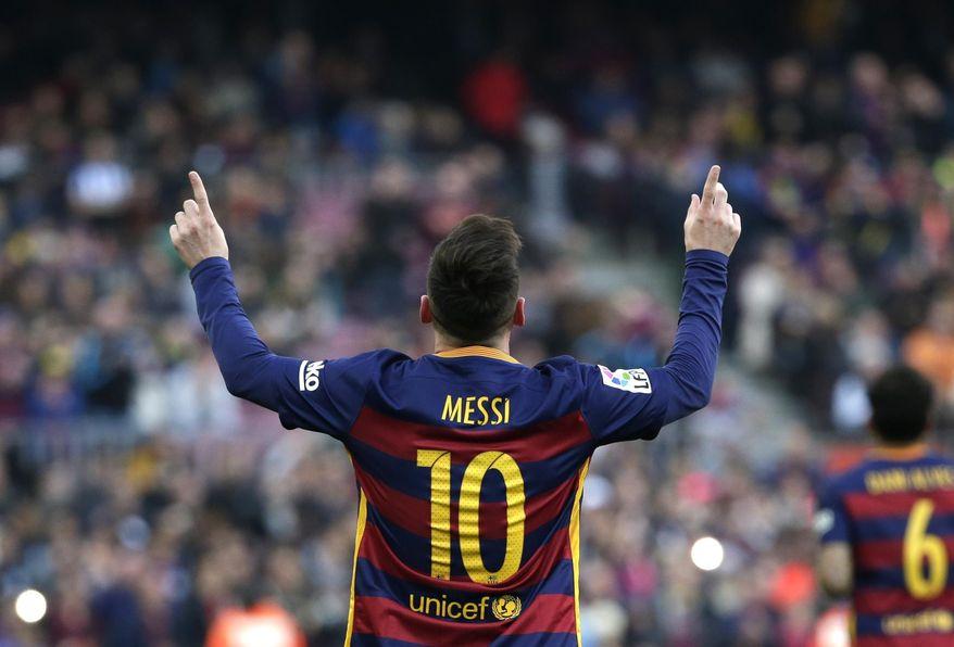 Barcelona's Lionel Messi celebrates scoring the opening goal during a Spanish La Liga soccer match between FC Barcelona and Deportivo Coruna at the Camp Nou stadium in Barcelona, Spain, Saturday, Dec. 12, 2015. (AP Photo/ Emilio Morenatti)