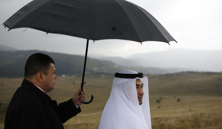 In this photo taken on Wednesday, Oct. 14, 2015   show Ismail Ahmed, right,  the head of Buroj Property Development from Dubai looks at the plateau where his company plans to build a euro 2.3 billion ($2.4 billion) town called Buroj Ozone on the Bjelasnica mountain area , less than 15 kilometers southwest of Sarajevo. As tourists from the Persian Gulf countries look to book their next holiday to escape the summer heat, Arab investors are betting on one unusual destination: Bosnia.  The mountainous Balkan country, which was devastated by the 1992-95 war, is becoming a popular destination for tourists from the United Arab Emirates, Kuwait and Qatar thanks to its comfortable summer temperatures and local Muslim community. (AP Photo/Amel Emric)