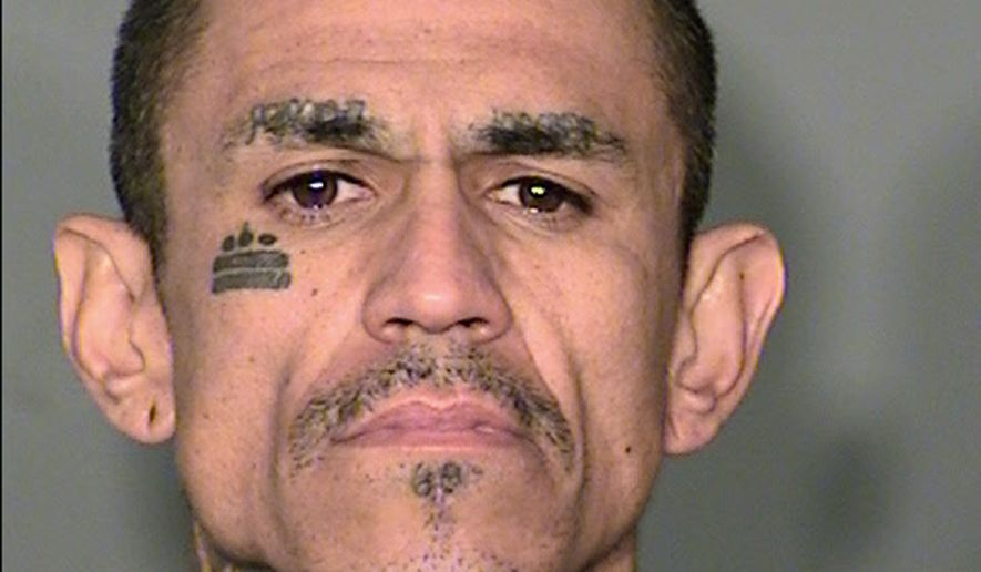 This booking photo provided by the Clark County Detention Center booking photo shows Marcial Casarez, 36, of Las Vegas, on Wednesday, Dec. 9, 2015. Casarez is due on Monday, Dec. 14, 2015, in Las Vegas Justice Court on murder and other charges in the Nov. 16, 2015 double-slaying of Jamel Colbert and his girlfriend, Shelby Taylor Robinson. (Las Vegas Metropolitan Police Department via AP)