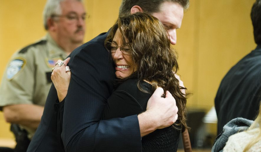 Lavonne Acre, mother of Levi Acre-Kendall, embraces defense attorney Doug Hazelton after the verdict acquitting Levi Acre-Kendall of all three charges of reckless and intentional homicide in the stabbing of a Wisconsin fisherman, on Monday, Dec. 14, 2015, at the Polk County Court in Balsam Lake, Wisc. (Mark Vancleave/Star Tribune via AP)  MANDATORY CREDIT; ST. PAUL PIONEER PRESS OUT; MAGS OUT; TWIN CITIES LOCAL TELEVISION OUT