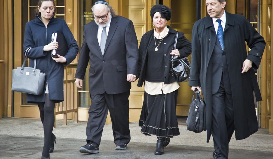 Jonathan Pollard, second from right, leaves federal court, Monday, Dec. 14, 2015, in New York. Pollard, 61, was released from prison last month after serving 30 years behind bars for spying for Israel. He returned to court to fight parole restrictions that allow the government to monitor his computer use and require him to wear a GPS monitoring device.  (AP Photo/Bebeto Matthews)