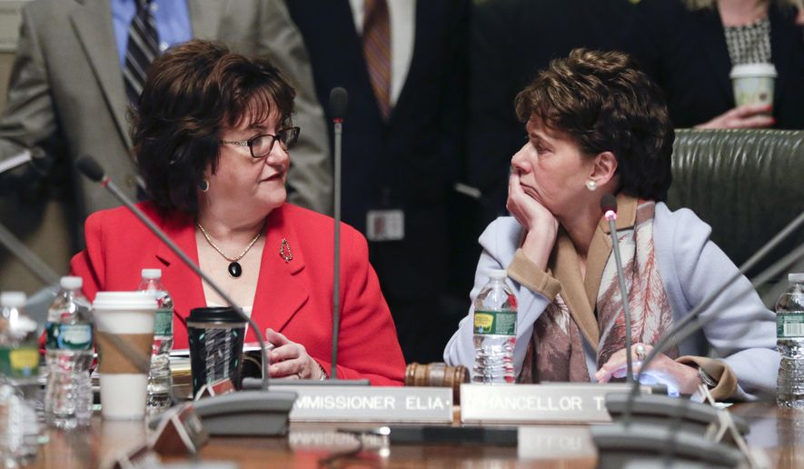 New York State Education Department Commissioner MaryEllen Elia, left, talks with Board of Regents Chancellor Merryl Tisch before a meeting on Monday, Dec. 14, 2015, in Albany, N.Y. (AP Photo/Mike Groll)