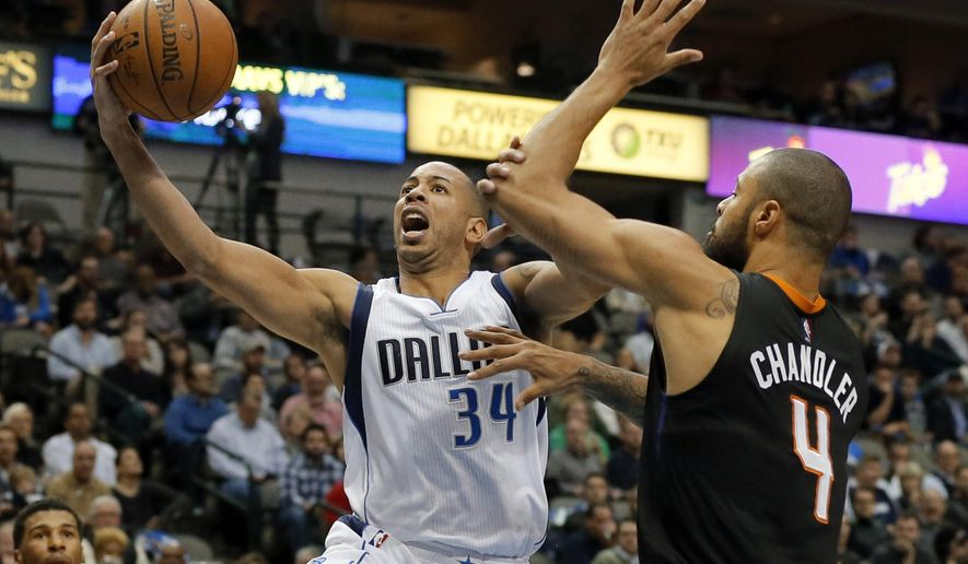 Dallas Mavericks guard Devin Harris (34) goes up for a shot as Phoenix Suns center Tyson Chandler (4) defends in the first half of an NBA basketball game, Monday, Dec. 14, 2015, in Dallas. (AP Photo/Tony Gutierrez)