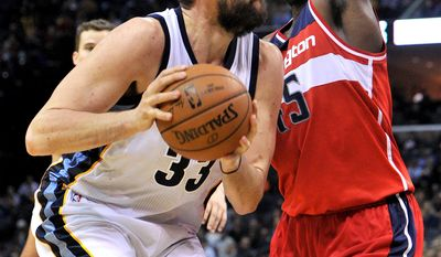 Memphis Grizzlies center Marc Gasol, left,looks to shoot against Washington Wizards center DeJuan Blair, right, in the second half of an NBA basketball game Monday, Dec. 14, 2015, in Memphis, Tenn. (AP Photo/Brandon Dill)