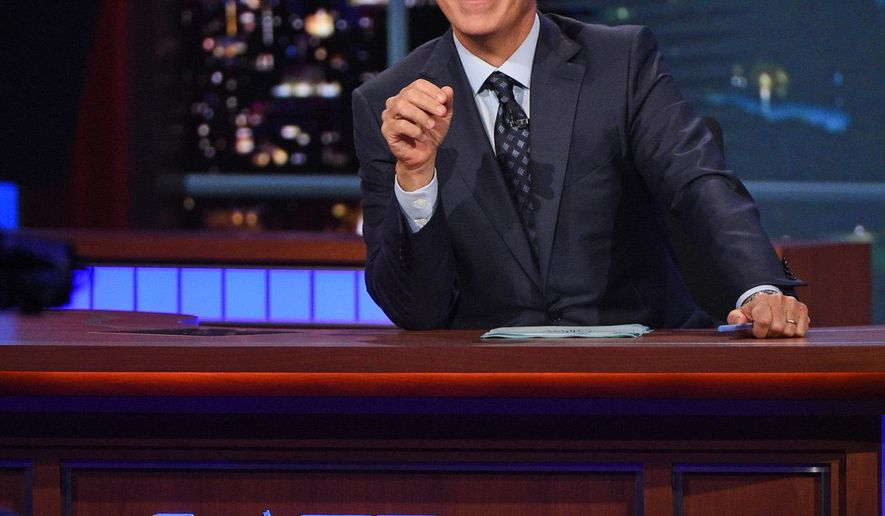 """In this Sept. 9, 2015 file image released by CBS, host Stephen Colbert appears during a taping of """"The Late Show with Stephen Colbert,"""" in New York. In May, David Letterman retired from CBS' """"Late Show"""" and in September, Colbert arrived as its new host. (Jeffrey R. Staab/CBS via AP, File)"""