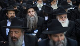 Lubavitch rabbis who were among a gathering of thousands of Orthodox rabbis from 86 countries wait for their group photo to be taken near Chabad-Lubavitch headquarters in the Brooklyn borough of New York, Sunday, Nov. 8, 2015. The group is in New York for the International Conference of Chabad-Lubavitch Emissaries, an annual event aimed at reviving Jewish awareness and practice around the world. (AP Photo/Andres Kudacki)