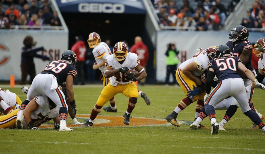 Washington Redskins running back Alfred Morris (46) rushes against the Chicago Bears during the first half of an NFL football game, Sunday, Dec. 13, 2015, in Chicago. (AP Photo/Charles Rex Arbogast)