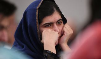 "Nobel Prize winner Malala Yousafzai listens to eyewitness accounts of the Taliban attack on the Army Public School in Peshawar, Pakistan, which took place on Dec. 16, 2014, and killed 150 people, as she attends the ""Poppies for Peace in Peshawar"" event in Birmingham, central England, Tuesday Dec. 15, 2015. The 18-year-old said comments such as those by controversial United States presidential hopeful Donald Trump could ""radicalize more terrorists"" and urged politicians to think carefully before speaking. (Joe Giddens/PA via AP)"